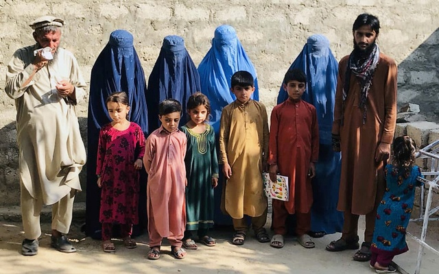 Mohammed Jafar, 21, poses for a picture along with widows of his three brothers, their children and his father, in Kunar, Afghanistan August 7, 2020. His brothers were killed in a Taliban suicide attack in 2016 in Kunar province and their wives were later married to him. Reuters