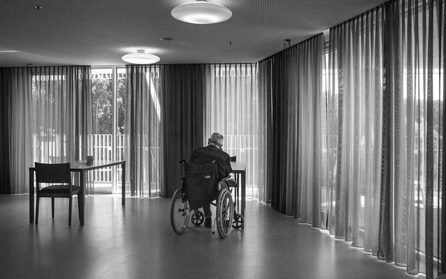 A resident at Val des Fleurs, a public nursing home in Brussels, waits for their lunch to be delivered, on June 23, 2020. Warnings had piled up for years that nursing homes were vulnerable, the coronavirus pandemic sent them to the back of the line for equipment and care. (Mauricio Lima/The New York Times)