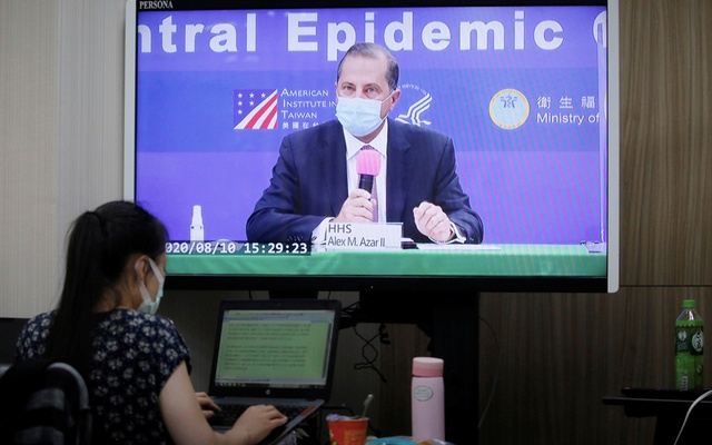 US Secretary of Health and Human Services Alex Azar is seen on a screen as he speaks during a news conference in Taipei, Taiwan, August 10, 2020. REUTERS