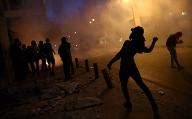 A demonstrator throws a rock during a protest following Tuesday's blast, in Beirut, Lebanon August 9, 2020. REUTERS