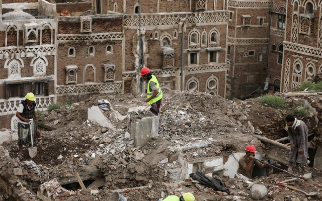 Workers demolish a building damaged by rain in the UNESCO World Heritage site of the old city of Sanaa, Yemen Aug 9, 2020. REUTERS