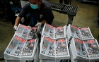 Hong Kong's Apple Daily vows to 'fight on' after owner arrested