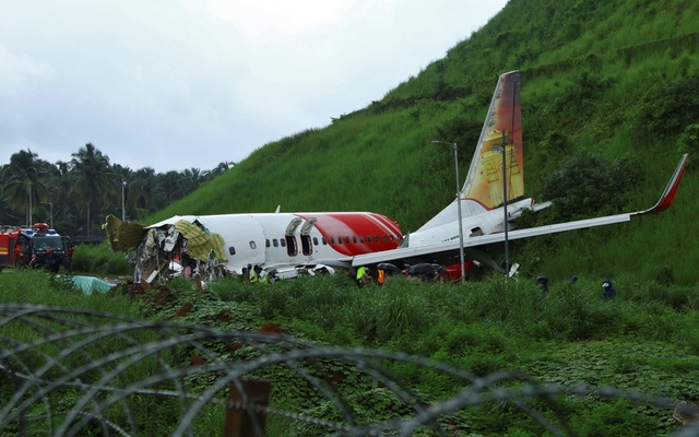 Officials inspect the site where a passenger plane crashed when it overshot the runway at the Calicut International Airport in Karipur, in the southern state of Kerala, India, August 8, 2020. REUTERS