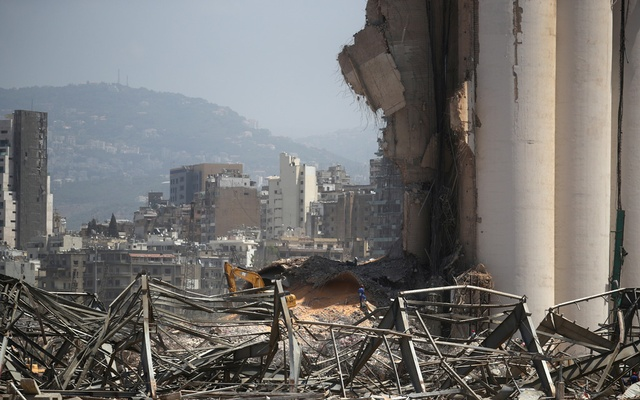 A man is seen at the site of Tuesday's blast in Beirut's port area, Lebanon August 8, 2020. REUTERS