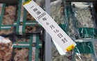 Frozen seafood products made of imported shrimps are seen inside a sealed freezer at a supermarket following a new outbreak of the coronavirus disease (COVID-19) in Beijing, China June 19, 2020. Reuters