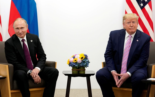 FILE PHOTO: US President Donald Trump meets with Russian President Vladimir Putin at the G20 Summit in Osaka, Japan June 28, 2019. REUTERS