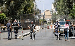 Members of Lebanese security forces block a road to stop protesters from reaching the UNESCO Palace where Lebanon's parliament is holding a session, in the aftermath of a massive explosion in Beirut's port area, in Beirut, Lebanon, Aug 13, 2020. REUTERS