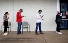 People who lost their jobs wait in line to file for unemployment following an outbreak of the coronavirus disease (COVID-19), at an Arkansas Workforce Center in Fayetteville, Arkansas, US April 6, 2020. REUTERS