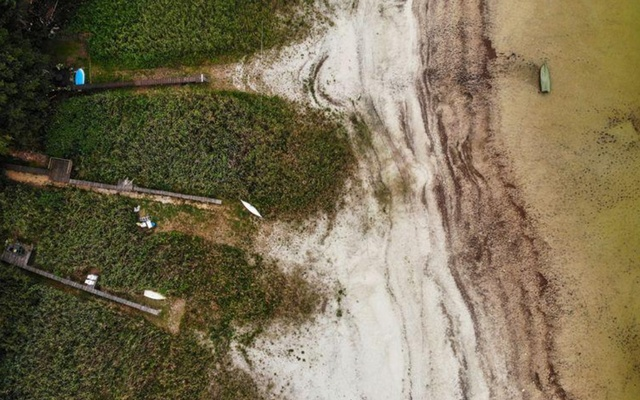 Jetties, which years ago still went into the water are now in the dry, are seen on the lake Seddin, southeast of Berlin, Germany Aug 13, 2020. REUTERS