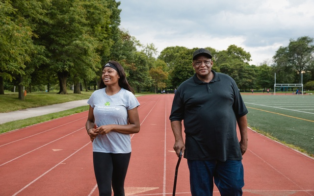 Katelyn Hutchison, a member of her school's track team, and her father, Kelly Hutchison Jackson Park running Track in Chicago on Aug 5, 2020. Hutchison's father has concerns about the coronavirus. Nolis Anderson/The New York Times