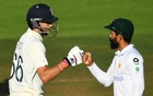 Cricket - Second Test - England v Pakistan - Ageas Bowl, Southampton, Britain - August 17, 2020 England's Joe Root and Pakistan's Fawad Alam fist pump after the test match is drawn, as play resumes behind closed doors following the outbreak of the coronavirus disease (COVID-19) Glyn Kirk/Pool via REUTERS