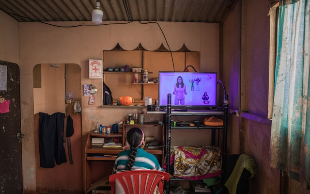 Delia Huamani, 10, watches a broadcasting of remote school lessons at her home in Pedregal, Peru, Aug 13, 2020. The New York Times