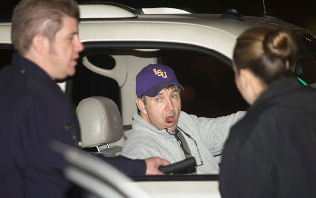 Jamie Spears, the father of pop singer Britney Spears, talks with two police officers at the entrance of the Cedars Sinai Hospital in Beverly Hills, California, January 4, 2008. Reuters