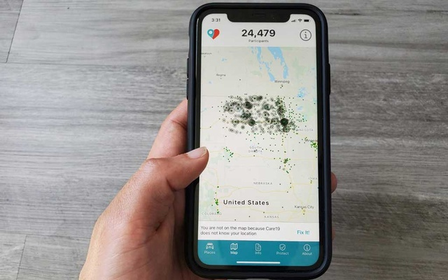 The Care19 mobile app, which the governors of North Dakota and South Dakota have asked residents to download to assist in contact tracing during the global outbreak of the coronavirus disease (COVID-19), is seen on a phone, US, Apr 24, 2020. REUTERS