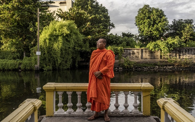 Luon Sovath, a Cambodian monk and rights activist who fled Cambodia, in Bangkok, July 2, 2020. Sovath, was the victim of a smear campaign this summer that relied on fake claims and hastily assembled social media accounts designed to discredit an outspoken critic of the country's authoritarian policies. A New York Times investigation found evidence that government employees were involved in the creation and posting of the videos on Facebook. (Adam Dean/The New York Times)