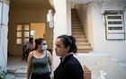 Lourdes Fakhri, 24, and Sandra Abinader, 18, are seen at the yard of the damaged building they live in, in the aftermath of a massive explosion at the port area, in Beirut, Lebanon, August 22, 2020. Picture taken August 22, 2020. REUTERS