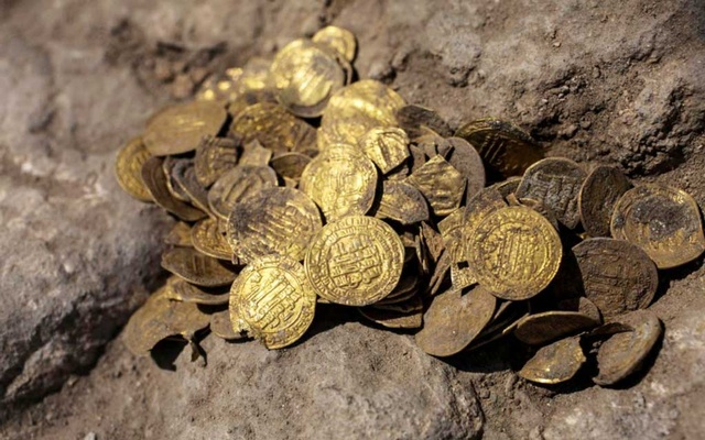 A hoard of gold coins, said by the Israel Antiquities Authority to date to the Abbasid dynasty, is seen after its discovery at an archaeological site in Central Israel Aug 18, 2020. REUTERS