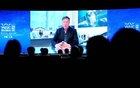 Tesla Inc Chief Executive Officer Elon Musk is seen on a screen during a video message at the opening ceremony of the World Artificial Intelligence Conference (WAIC) in Shanghai, China July 9, 2020. Reuters