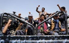 Houthi-affiliated security troopers shout slogans as they ride on the back of a patrol truck at the site of a protest against a decision by the United Arab Emirates to normalise ties with Israel, in Sanaa, Yemen August 22, 2020. REUTERS