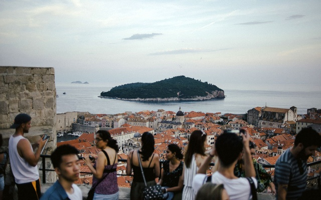 FILE -- Tourists overlooking the old town of Dubrovnik, Croatia, June 21, 2018. The city has struggled with overtourism. Can a post-vaccine return to travel be smarter and greener than it was before March 2020? Some in the tourism industry are betting on it. (Dmitry Kostyukov/The New York Times)