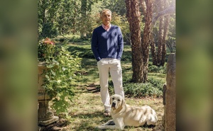 """Dan Brown, author of """"The Da Vinci Code,"""" with his dog, Winston, at his home in Rye Beach, N.H., Aug. 28, 2020. The author just released a classical music album for children — it happens to be one of the assets he and his wife are disputing in lawsuits over their divorce. (Cody O'Loughlin/The New York Times)"""