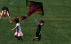 Children try to fly a kite in Central Park, in the Manhattan borough of New York City, New York, U.S., August 26, 2020. REUTERS/Carlo Allegri