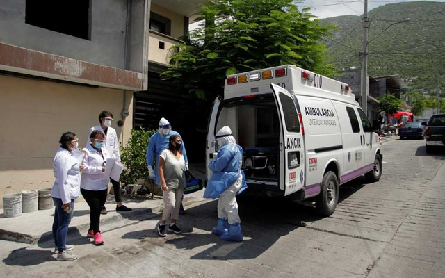 Healthcare workers speak with a woman before transporting her in an ambulance during a house by house walk to test people for the coronavirus disease (COVID-19), in Monterrey, Mexico August 5, 2020. REUTERS