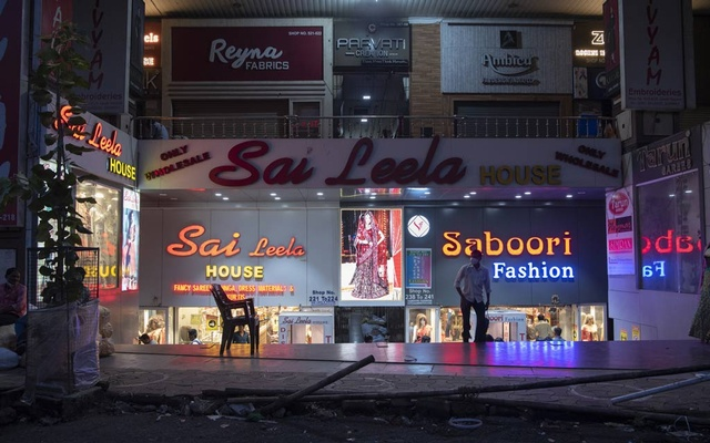 Fabric stores at a market where business has slowed dramatically amidst the economic fallout from the spreading coronavirus pandemic, in Surat, India, Sept. 2, 2020. The country's ambitions to become a global power, lift its poor and update its military have been set back by a sharp economic plunge, soaring coronavirus infections and a widening sense of malaise. (Saumya Khandelwal/The New York Times)