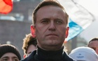FILE PHOTO: Russian opposition politician Alexei Navalny takes part in a rally to mark the 5th anniversary of opposition politician Boris Nemtsov's murder and to protest against proposed amendments to the country's constitution, in Moscow, Russia February 29, 2020. REUTERS