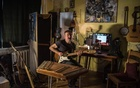 Musician Pit Pawlaw in his apartment in Minsk, Belarus, Aug 28, 2020. Forced underground in the 1990s to a life of cover gigs and guitar lessons, Belarusian rockers are re-emerging amid the country's political awakening. Sergey Ponomarev/The New York Times