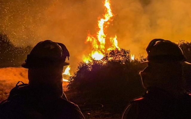 Firefighters work to extinguish a fire in Alpine, California, US, September 6, 2020, in this picture obtained from social media. Picture taken September 6, 2020. Steve Russo/via REUTERS