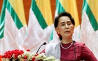 FILE PHOTO: Myanmar State Counsellor Aung San Suu Kyi delivers a speech to the nation regarding the Rakhine and Rohingya situation, in Naypyitaw, Myanmar, September 19, 2017. REUTERS/Soe Zeya Tun