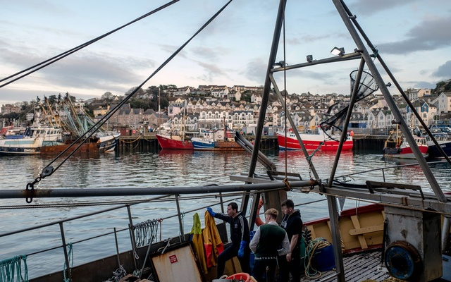Fishermen wait to set sail from Brixham, England, on Feb. 26, 2020. Hotly disputed points in the Brexit negotiations include state subsidies of British fishing rights. (Andrew Testa/The New York Times)