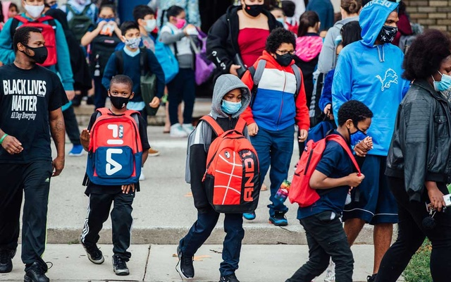 Students are picked up after the first day of class at Harms Elementary School in Detroit, Sept 8, 2020. With many districts across the country opting for online learning, a range of technical issues marred the first day of classes. (Allison Farrand/The New York Times)