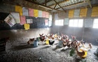 Chickens are seen in a classroom converted into a poultry house because of the Coronavirus disease (COVID-19) in the town of Wang'uru, Kenya, August 28, 2020. REUTERS