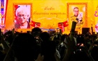 A still image from a video shows images of historian Somsak Jeamteerasakul and former diplomat Pavin Chachavalpongpun projected onto a giant screen at a Thammasat university during in demonstration in Bangkok, Thailand August 10, 2020. The banner reads