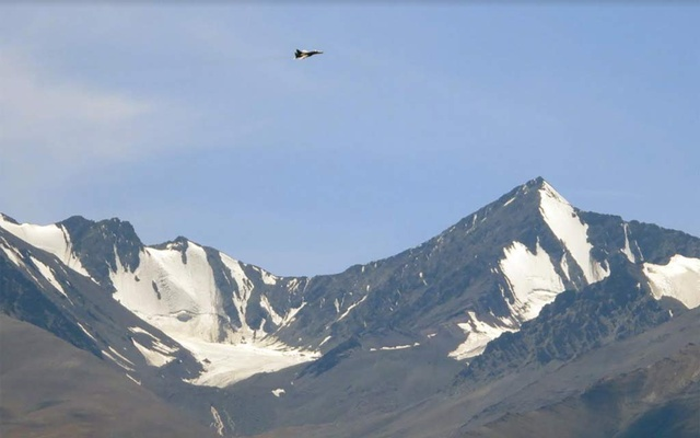 An Indian fighter plane flies over a mountain range in Leh in the Ladakh region September 2, 2020. REUTERS