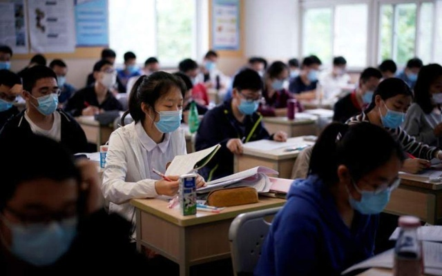 Students wearing face masks in a high school, in Shanghai, China, on May 7, 2020. REUTERS