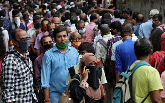 People wait to board passenger buses during rush hour at a bus terminal, amidst the coronavirus disease (COVID-19) outbreak, in Mumbai, India, Sept 9, 2020. REUTERS