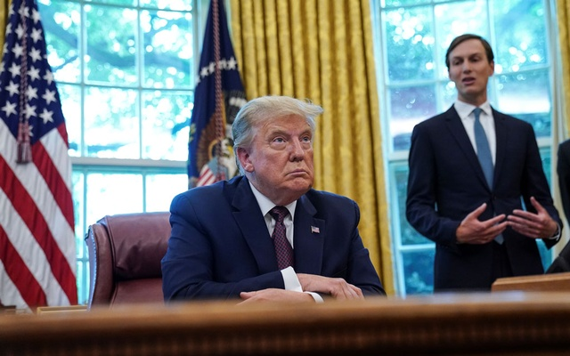 US President Donald President Trump faces reporters after it was announced Bahrain has joined the United Arab Emirates in striking an agreement to normalise relations with Israel as White House senior adviser Jared Kushner stands by in the Oval Office at the White House in Washington, US, September 11, 2020. Reuters