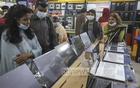 As the classes are held online with the educational institutions closed, students are visiting BCS Computer City in Dhaka with their parents to buy computers or accessories. Photo: Asif Mahmud Ove