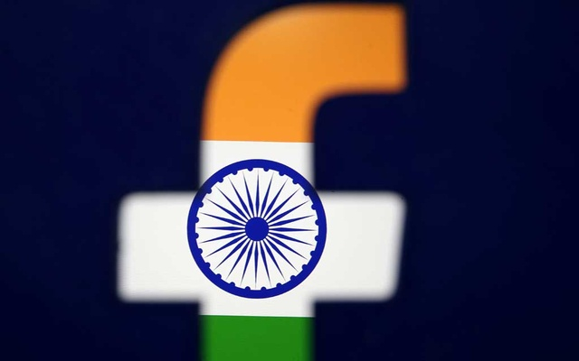 India's flag is seen through a 3D printed Facebook logo in this illustration picture, April 8, 2019. REUTERS