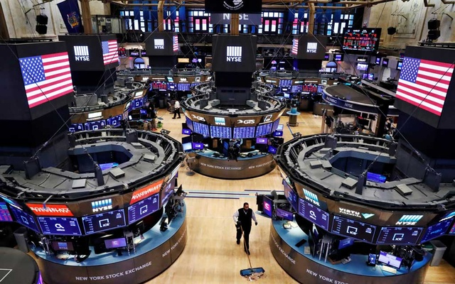 A worker cleans the floor of the New York Stock Exchange (NYSE) , US, March 20, 2020. REUTERS