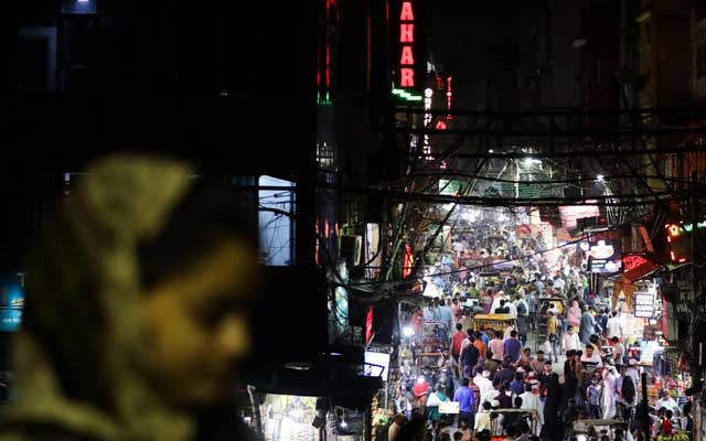 People are seen in a crowded street amidst the spread of the coronavirus disease (COVID-19), in the old quarters of Delhi, India, Sept 13, 2020. REUTERS