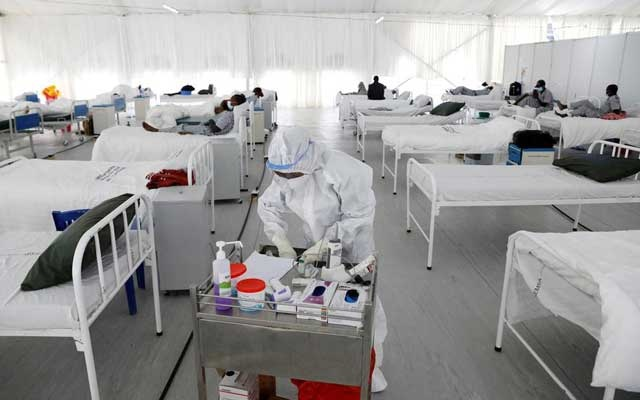 FILE PHOTO: A nurse works inside a field hospital built on a soccer stadium in Machakos, as the number of confirmed coronavirus disease (COVID-19) cases continues to rise in Kenya, July 23, 2020. Picture taken July 23, 2020.REUTERS