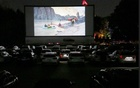 People sit in cars for an outdoor movie projection during Beijing International Film Festival at the Maple Garden Drive-in Cinema, following the coronavirus disease (COVID-19) outbreak, in Beijing, China Aug 24, 2020. REUTERS