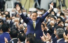 apanese Chief Cabinet Secretary Yoshihide Suga gestures as he is elected as new head of the ruling party at the Liberal Democratic Party's (LDP) leadership election paving the way for him to replace Prime Minister Shinzo Abe, in Tokyo, Japan September 14, 2020. Kyodo via REUTERS