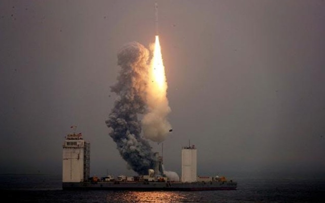 A Long March 11 carrier rocket takes off from a mobile launch platform in the Yellow sea of Shandong province, China June 5, 2019. China Daily via Reuters
