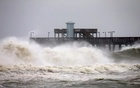 Waves crash along a pier as Hurricane Sally approaches in Gulf Shores, Alabama, September 15.  REUTERS/Jonathan Bachman