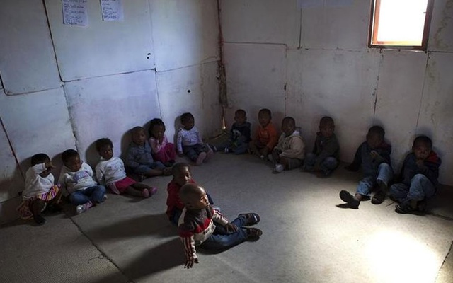 Toddlers listen as a volunteer from Simelela, an organisation dealing with sexual violence, teaches them about inappropriate touching and sexual abuse at a pre-school in Cape Town's Khayelitsha township Feb 17, 2010. REUTERS